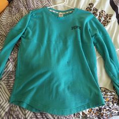 PINK jersey Newish, great condition, little black speck on the front. PINK Victoria's Secret Sweaters