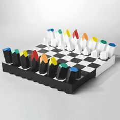 Classic Black and White PRISMA set and board with colorful piece details for the more traditional chess set enthusiast.