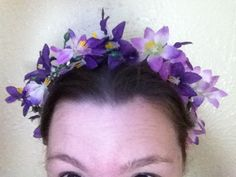 Whimsical purple flower crown with gold ribbon detailing. Light weight for comfortable all day wear.