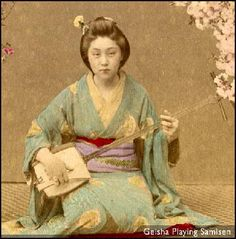 Geisha playing samisen (vintage photo)