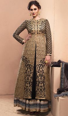 This can be worn for different day events by donning this black color chanderi silk and net Anarkali style suit. Ethnic lace and resham work within attire adds a sign of elegance statement with a look. #anklelengthdress #gorgeousblacksuit #indowesternanarkali