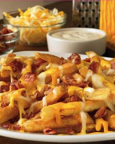 Bacon crumbled cheese fries. OHHHH MYY GOOOD. my mouth is watering!!!!! ahhhh, talk about temptations!! gimme gimme gimme! :D