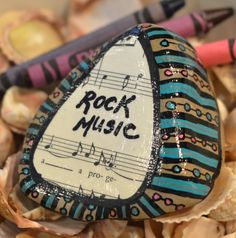 """ROCK MUSIC"" Scooped up from the waters of Cayuga Lake, in the Finger Lakes region of New York State, this rock was hand painted. Pebble Painting, Pebble Art, Stone Painting, Stone Crafts, Rock Crafts, Pebble Stone, Stone Art, Rock And Roll, Music Painting"