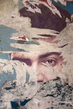 This photo shows the rural decay of old posters and wallpapers. It could imply…