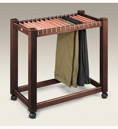 This Rolling Pant Trolley with Cedar Hangers from Woodlore provides a convenient mobile place to store dress slacks while preserving their freshly pressed appearance and infusing them with the fresh scent of aromatic cedar at the same time. With storage space for up to fifteen pairs of slacks at a time this rolling pan