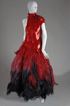 * Dress made from medical slides stained to look like blood on top and dyed ostrich feathers feathers on the bottom - Alexander McQueen
