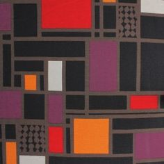 Tissu jersey en coton et élasthanne à motifs géométriques rouge, brun, orange et beige sur fond noir  9,90 €/m