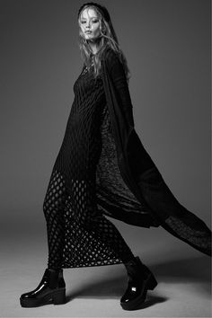 Long black perforated pattern dress.│ H&M Divided