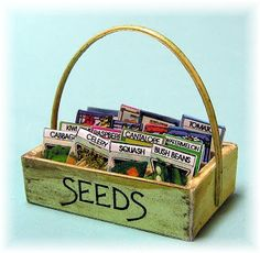 Lots of wonderful miniature garden ideas, including potting bench, seeds, signs, flower boxes.