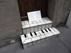LOVELY PIANO...He takes a detail, a manhole, a crack , a line along a wall and makes a small work of art. It' street art By: French artist OakOak (nickname) lives and works in St. Etienne
