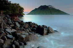 Pantai Sulamadaha, Maluku, Ternate - Indonesia.  I believe this is a view of the island of Hiri.  Very photogenic islands around here.