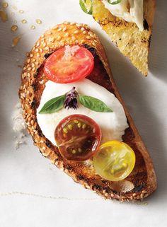 Tomato, Mozzarella & Thai Basil Crostini Recipe  at Epicurious.com