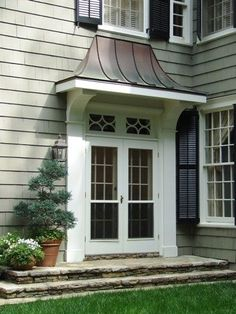 lantern over garage doors | May want doors to be a natural stain. And lanterns of course!