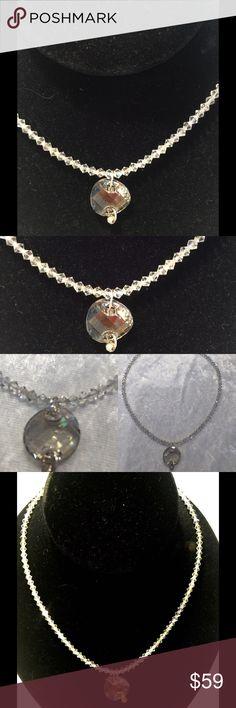 Swarovski Crystal necklace Hand Made Swarovski Crystal necklace made by local designer by hand. Clear crystals with light gray center stone disk. Silver closure. Original price $160 Jewelry Necklaces