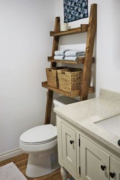 Speaking of cabinets — skip traditional cabinets and opt for a more casual approach. Try a ladder, especially one with tray-like shelves, to maximize space above your toilet. Jute baskets provide storage, while the exposed shelves make the ladder a perfect spot for a sprawling houseplant. See more at Ana White »