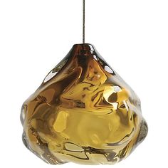 The Siemon & Salazar Happy Pendant explores the inherent reflective and malleable qualities of glass. The result is a thick and brilliant drop of glass. The various hand-formed ripples are infinitely refractive, and add a sparkling element to any interior space. Available in a variety of glass colors.