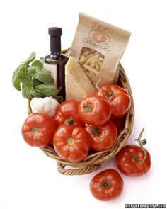 Gift-Put tomatoes in a basket with pasta and the basic ingredients for a traditional sauce: olive oil, fresh basil, garlic, and a wedge of Parmesan.