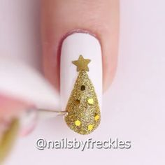 Happy New Year! Nail tutorial by @nailsbyfreckles using snowflake, bow, star stickers and straight nail tape from Whats Up Nails whatsupnails.com (link in bio) #Padgram