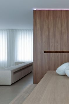 Sleek combination of white and wood, Villa SB by Filip Deslee _