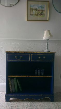 Lovely bookcase/hall console painted in Annie Sloan Napoleonic Blue Chalk Paint with gold leaf detailing
