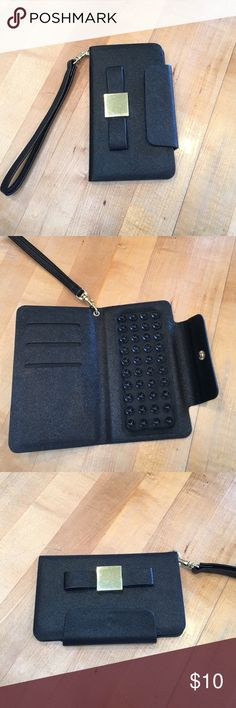 Black bow cell phone case wallet This chic iPhone wallet it's nice and light with suction cups to hold it in place. With credit card slots compatible with iPhones cells Accessories Phone Cases