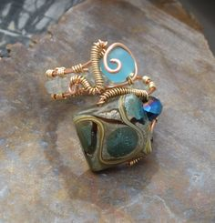 Lampwork Bead Wire Wrapped Copper Adjustable Ring with Sea Glass Bead. $28.00, via Etsy.