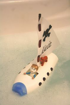 shampoo bottle boat! I always wanted to find something to do with shampoo bottles!