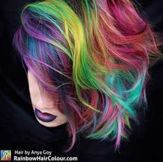 Anya Goy is known for her rainbow hair delights, and luckily for us, she uses Manic Panic on her masterpieces! For this beautiful picture, Electric Banana, Atomic Turquoise, Hot Hot Pink, and Purple Haze were used, and she intermixed the colors during application to get a range of hues with varying dimensions. We LOVE the pink to purple ombre lip paired with the hair, so to get this look, layer our Lethal Lipsticks in Fleurs Du Mal, Cleo Rose, and Violet Night.