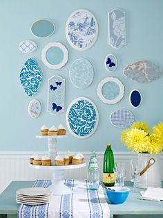 Mix and Match Wallpaper Display - use leftover wallpaper or art paper scraps by covering inexpensive wooden plaques or thrifted plates with fun borders with a coat of paint and then some fun wallpaper. Cover an entire wall or just a corner, either way it's just magnificent!