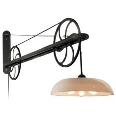 Large Pulley Industrial Swing Arm Lamp | From a unique collection of antique and modern wall lights and sconces at https://www.1stdibs.com/furniture/lighting/sconces-wall-lights/