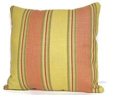 Soft cotton polyester blend home decor fabric in yellow, coral, green, and brown stripes. Generous envelope back fits smoothly on standard 16 inch insert.   Sizing:  Pillow cover sizes are given for the largest standard pillow insert that will comfortably fit the cover. The 20 inch covers, for instance, will fit snugly on a 20-inch fiberfill insert, less snugly on a 20 inch feather insert, and loosely on a standard 18-inch insert.   If you are unsure of the size for an existing pillow…