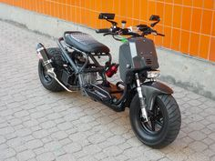 I'm not much for scooters but something about a Honda ruckus with the extended swing arm and a larger engine swapped in just does it for me.