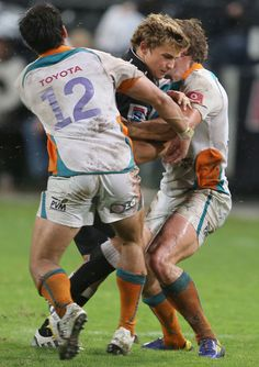 Patrick Lambie Photos - Patrick Lambie is tackled by Robert Ebersohn and Johan Sadie during the Super Rugby match between The Sharks and Toyota Cheetahs from Kings Park on April 2013 in Durban, South Africa. - Super Rugby Rd 10 - Sharks v Cheetahs Rugby Sport, Rugby Men, Rugby Girls, Durban South Africa, Super Rugby, Kings Park, Kwazulu Natal, Rugby Players, Cheetahs