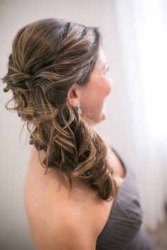 Elegant sideswept bridesmaid updo: http://www.stylemepretty.com/rhode-island-weddings/newport-ri/2016/04/05/bright-and-elegant-winter-inspired-wedding-on-goat-island/ | Photography: Zev Fisher - http://www.zevfisher.com/
