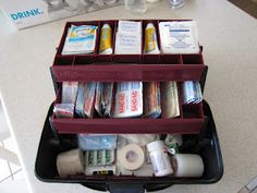 "My initial attempt at our ""main"" first-aid kit, in a tackle box.  I've got wipes, neosporin, gauze pads, tape, tweezers, gloves, masks, pain killer (adult and children), ace bandage, large gauze pads, alcohol wipes and a various assortment of bandages."