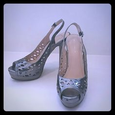 Beautiful Silver Pumps Silver BCBGeneration pumps gently worn two times. Just like new!! Must have!! BCBGeneration Shoes Heels
