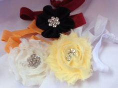 Knotty Head Bands with Flower Embellishment: $8.00. Styles and colors not guaranteed. This item is currently at our Granite Bay Location. Call or Email for more information. Email: polkadotsproshop@gmail.com Phone: 916-791-9070