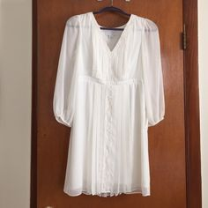 NWT Jessica Simpson ivory dress Jessica Simpson Ivory v-neck sheer dress with lining. Long sleeve size 4 fits true to size. Brand new with tags and never worn! Jessica Simpson Dresses Midi