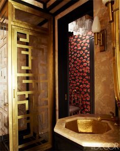 Golden Glamour - Cameron Diaz's Manhattan guest bath shines with a brass sink, by Bates and Bates, and fittings, by Waterworks. The gilded shower stall is custom  made.  - ELLEDecor.com (=)