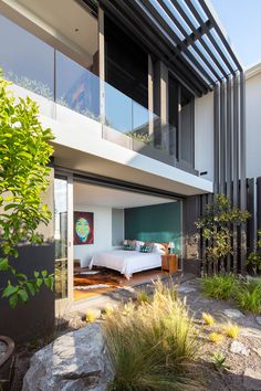 This modern bedroom opens up to a small private garden.