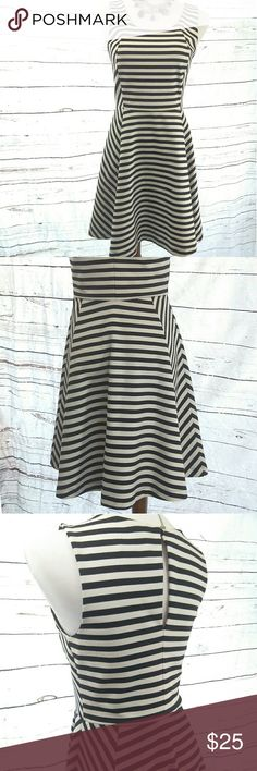 NWOT EXPRESS Fit and Flare Black & White Dress MINT CONDITION! NWOT. Too large for me.  Women's size Small. Would fit a junior who wears a small like a large small/medium. Beautiful black & white sleeveless fit and flare dress! Keyhole back with silver button closure. Fully lined from the waist up! Quality material, of which I would describe as having the weightiness of neoprene with far more movement and breathability! Not a thread out of place. Would look amazing for work or play with a…