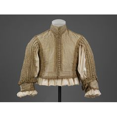 Doublet  Place of origin: Great Britain, United Kingdom (made)  Italy (woven)  Date: 1650-1665 (made)  Artist/Maker: Unknown (production)  Materials and Techniques: Silver-gilt silk tissue, trimmed with silver-gilt bobbin lace, lined with silk taffeta and reinforced with linen, hand-sewn with silk and linen thread | V Search the Collections