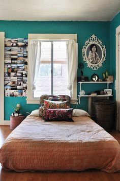 love the wall color as an accent wall. maybe paired with rusted red accents. maybe yellows.