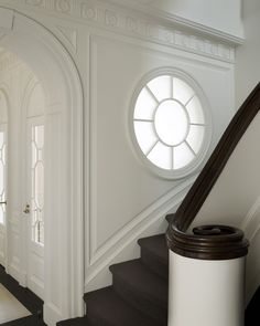 The MOST beautiful stairway, hallway, White walls, dark floors, curved staircase, round window, arched doorways, beautiful!