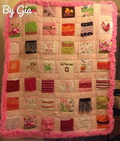 Quilt of favorite outfits, bibs, swim suit, and Halloween costume from first year. Ruffle is from her first tutu.