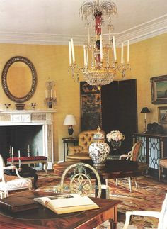"""""""Washington DC home with a red, gold and cream Aubusson rug. A black and gold screen and oval mirror create pleasing contrasts against the sunny yellow walls."""" Albert Hadley, designer"""
