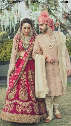 Luxurious Bridel Groom Dress In Red Lahnga Choli And Pinkish Sherwani.Bridal Lahnga Choli With Pure Dabka,Zari,Nagh,And, Threads Work.Groom Sherwani Based On Pure Jamawar Fabric In Light Pinkish Color.