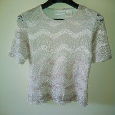 Hold - 1990s Lace Short Sleeve Top Cream lace short sleeve summer top. Front & back have a sheer Polyester lining. The sleeves are not lined. Lace is 100% Nylon. Lining is 100% Polyester. Very good condition! Hand wash cold & dry flat. Not currently for sale. Christie & Jill Tops