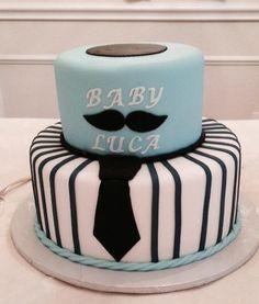 Black, white and blue mustache cake.