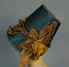 LOT 467 - whitakerauction Teal silk satin poke bonnet with appliquéd cloth leaves, vines, and flowers, and yellow moiré ribbon ties, c. Victorian Hats, Victorian Fashion, Vintage Fashion, Classy Fashion, Gothic Fashion, Historical Costume, Historical Clothing, Historical Dress, Vintage Clothing